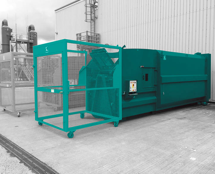 portable compactor with enclosed hopper