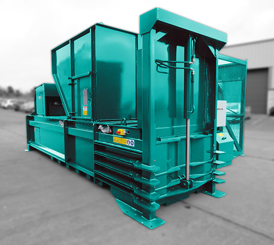 Side view of a moovmor waste baler