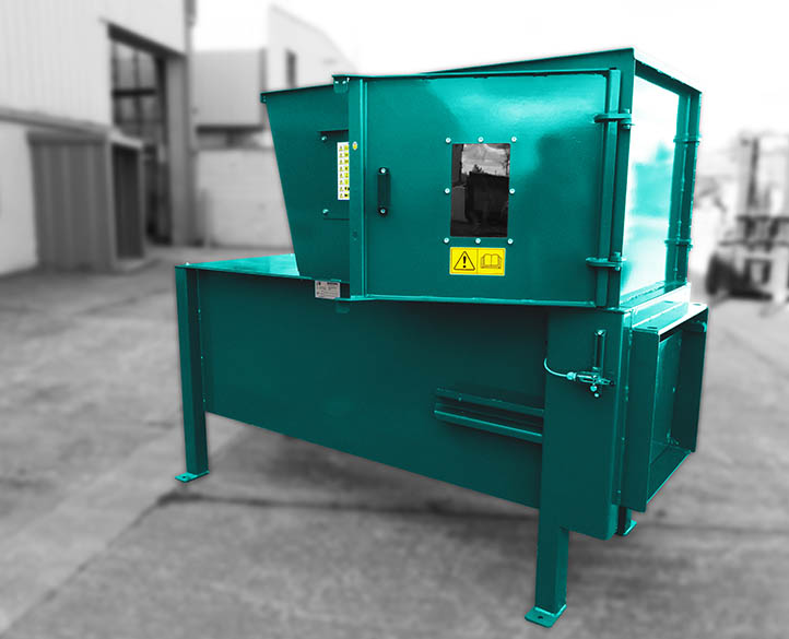 side view of a mini static compactor