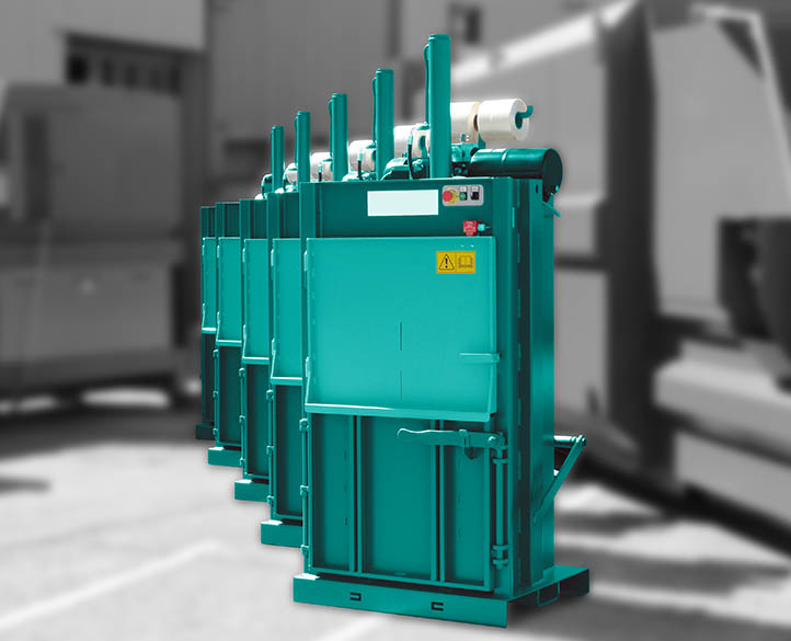 a line up of several entry level vertical balers for small waste volumes