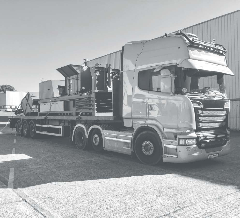 Large truck distributing one of Movmoors horizontal waste balers