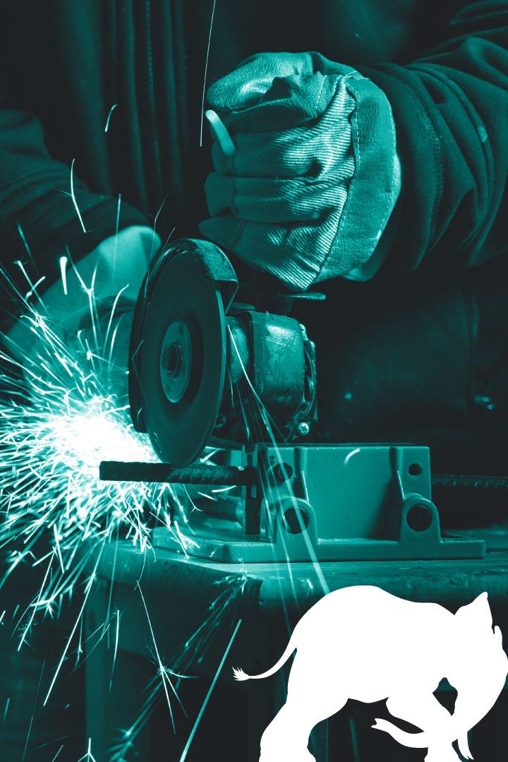 Craftsman cutting a wrought iron rod